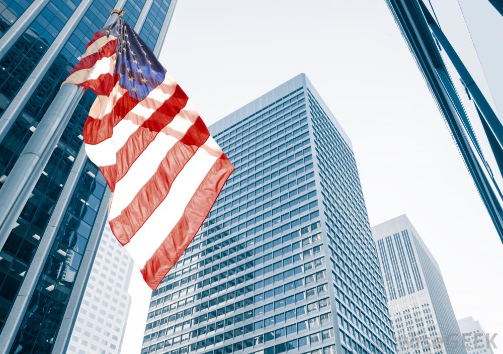 us-flag-near-large-buildings